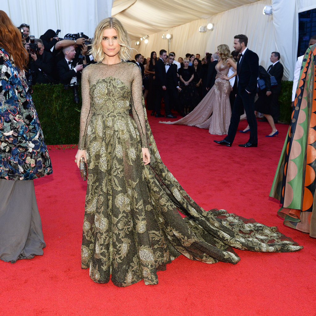 Blake Lively and Ryan Reynolds popped up behind Kate Mara.