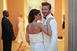 Victoria and David shared a supersweet moment at the Met entrance.