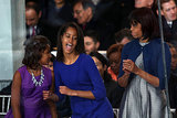 At the 2013 inaugural parade Sasha, Michelle, and Malia especially had a good time.
