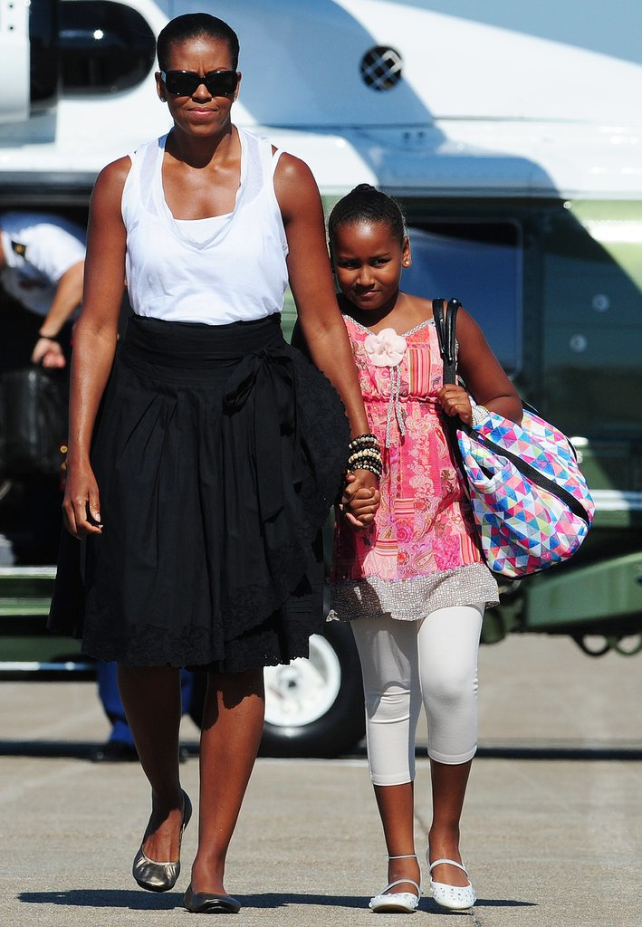 In August 2010, Sasha held on tight to her mother's hand as they headed out of Massachusetts on Air Force One.