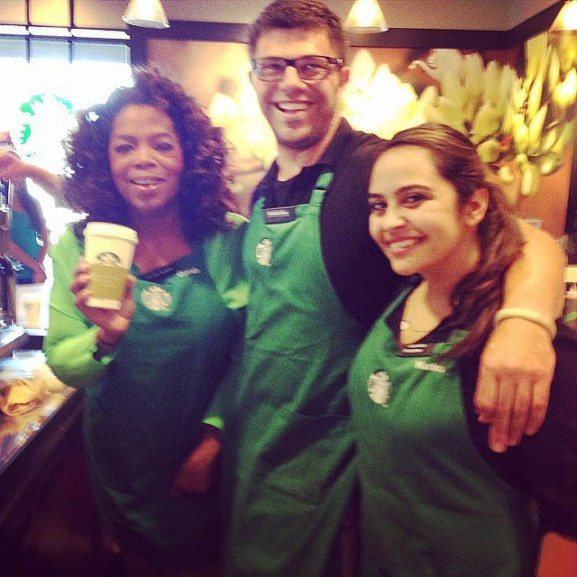 "Yes, that's Oprah Winfrey behind the counter at Starbucks, promoting her special chai tea drink. ""Getting my Chai on with partners @Starbucks. Bring your Mom! #oprahchai,"" she captioned the picture. Source: Instagram user oprah"