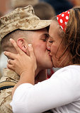 Lance Cpl. Jeffery Brant got a big welcome home kiss from his girlfriend, Brooke Africa, on May 12, 2008, at Camp Lejeune, NC.