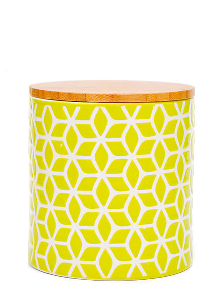 For a bright and organized office, use this stamped storage jar ($20) to hold all your knickknacks.