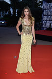 Nina Dobrev wore a yellow gown.