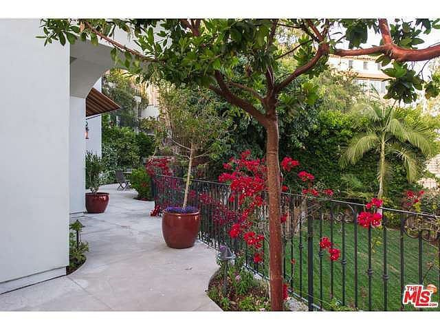 Colorful bougainvillea brightens up the home's walkways. Source: Coldwell Banker