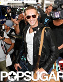 Chris Martin smiled while walking through LAX on Thursday.