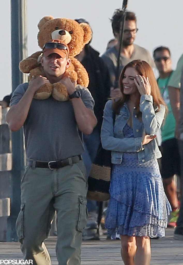 Bradley Cooper and Sienna Miller walked around with a teddy bear on the set of American Sniper in LA on Wednesday.