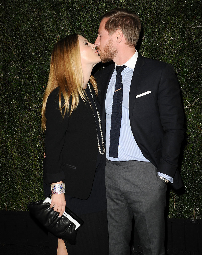 They shared a sweet smooch at the release party for Drew's book, Find It in Everything at the Chanel boutique in LA in January 2014.