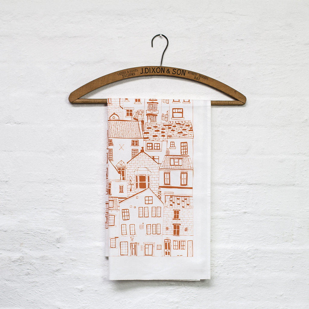 A nod to Summer travel, this tea towel ($12) will make a fun addition to your kitchen.