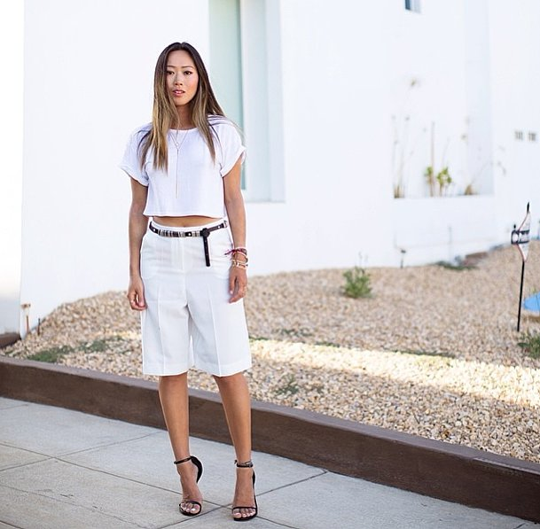 Temper a belly-baring shirt with cool tomboy shorts, then amp it all up with your sexiest heels. Source: Instagram user songofstyle