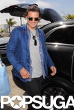 Orlando Bloom grinned as he arrived at LAX on Monday.