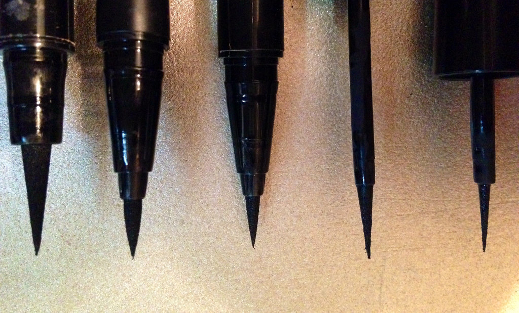 The Revlon Skinny Liner is on the far right, and clearly boasts the slenderest brush from base to tip out of all of them.  What's more, this product also features a raven-black formula that d