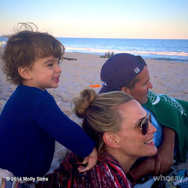 Molly Sims and Scott and Brooks Stuber took in the sunset in the Hamptons. Source: Instagram user mollybsims