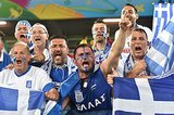 In Brazil, Greece fans held up flags and cheered ahead of the game against Japan.