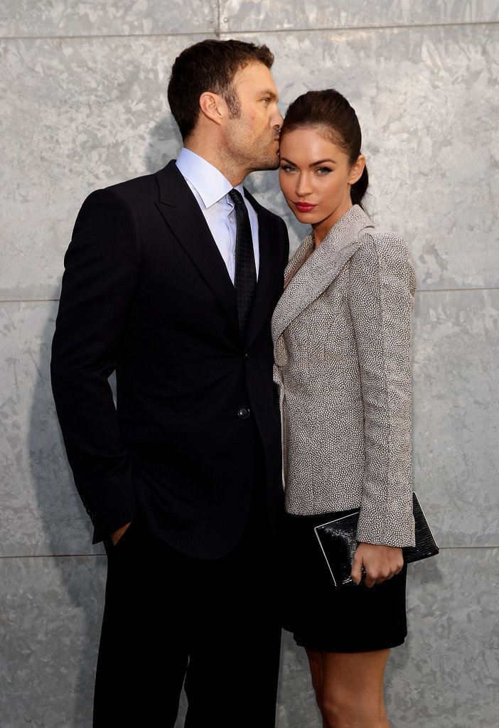 Brian planted a sweet kiss on Megan as they attended the Giorgio Armani fashion show in Milan, Italy, back in September 2010.