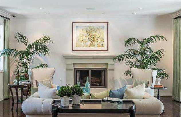 The main living room has a polished California vibe.  Source: Redfin