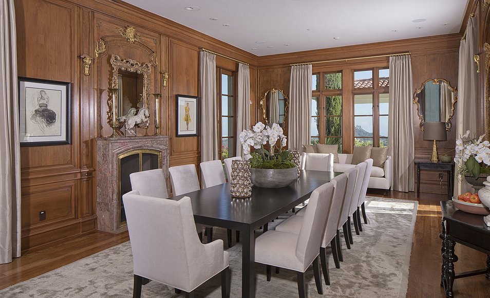 The large dining room is complete with original European details.  Source: Lynn Teschner