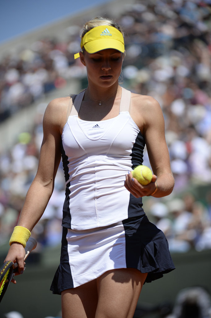 White and navy separates paired with bright yellow accessories made for a flattering look on Russia's Maria Kirilenko at the 2013 French Open.