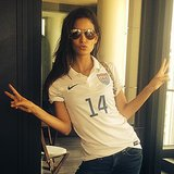 Lily Aldridge flashed peace signs while rocking a Team USA jersey. Source: Instagram user llilyaldridge