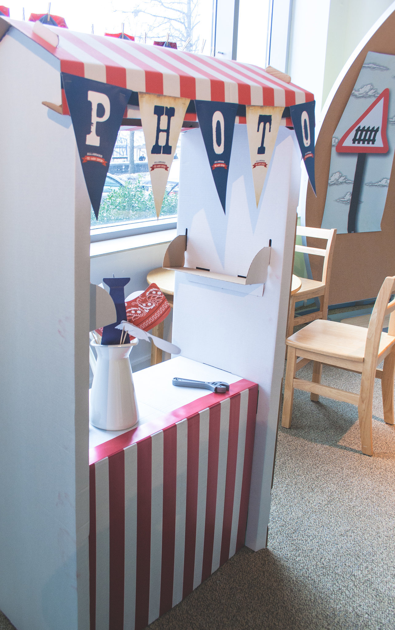 """""""[My favorite touch was] definitely the photo booth! We took a simple Ikea stock market stand and decorated it with our own colors to match the theme. We added a flag garland, and it looked spectacular,"""" Keren said. Source:  Clay Williams and Alex Nirenberg for Keren Precel Events"""
