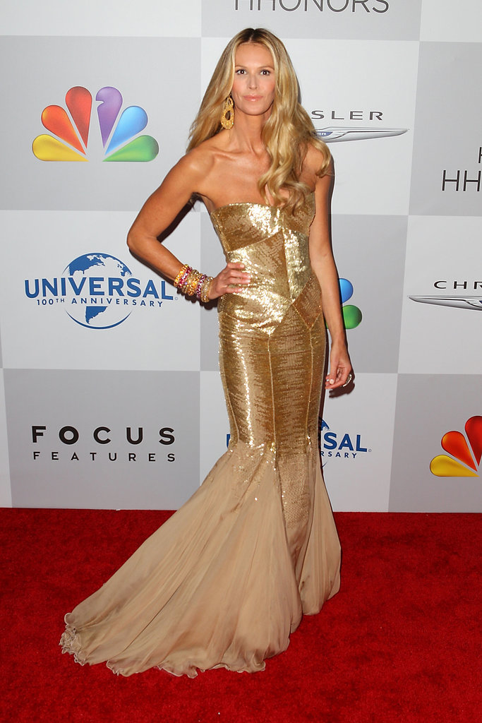 Elle Macpherson channelled a '70s disco diva in this opulent gold fishtail gown.