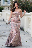 English rose Kelly Brook was snapped in a strapless silk floral-print dress by Azagury whilst on her way to Elton John's White Tie &Tiara Ball in 2012.