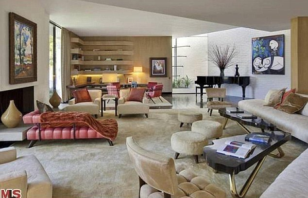 The midcentury modern living room will no doubt host many parties.  Source: MLS