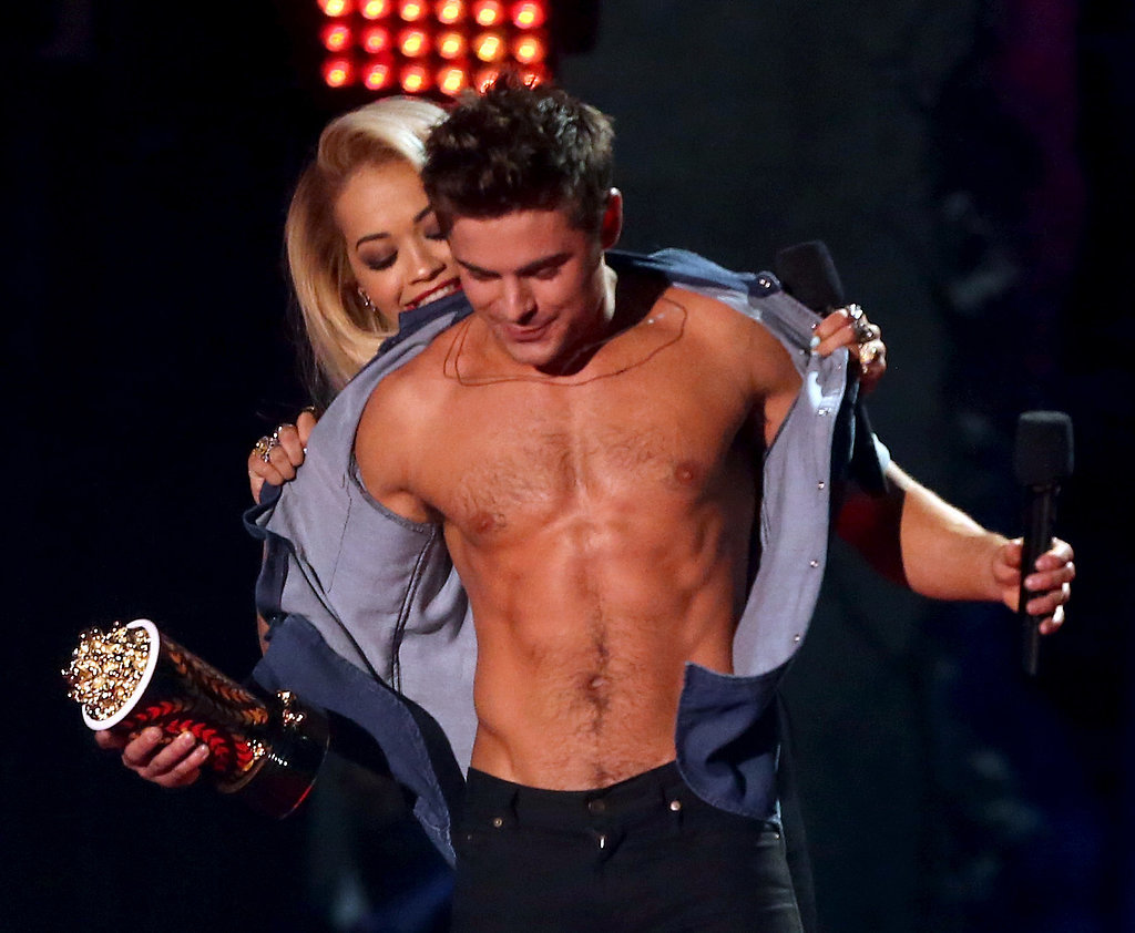 Do not envy Rita Ora's proximity to his abs.