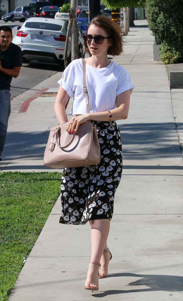 Lily Collins must be a sartorial goddess. Because, really, how many girls are inspired to create an ensemble like this around a loose, boxy tee? Scroll down to gather the goods, then show off your killer fashion sense with pride, not to mention a whole lot of comfort. Source: Getty / Bauer-Griffin