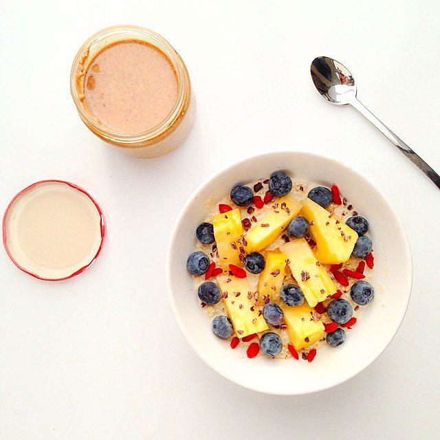 Take a trip to the tropics by adding pineapple and papaya to overnight oats.  Source: Instagram user __lemonpie