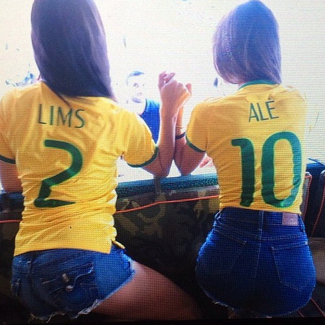 Alessandra Ambrosio and Adriana Lima held hands while watching the Brazil vs. Germany World Cup game. Source: Instagram user alessandraambrosio
