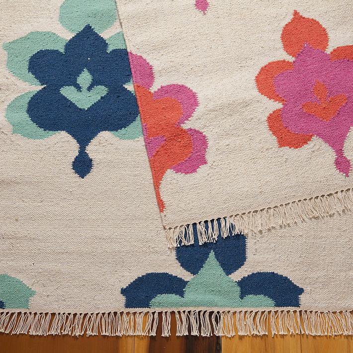 Colorful dhurries are all the rage, and this Leaf Medallion Lurex Rug ($140, originally $400) excellently blends bold colors with an organic motif.