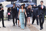 On Wednesday, Kim Kardashian was covered by an umbrella at the Valentino show at Haute Couture Fashion Week in Paris.