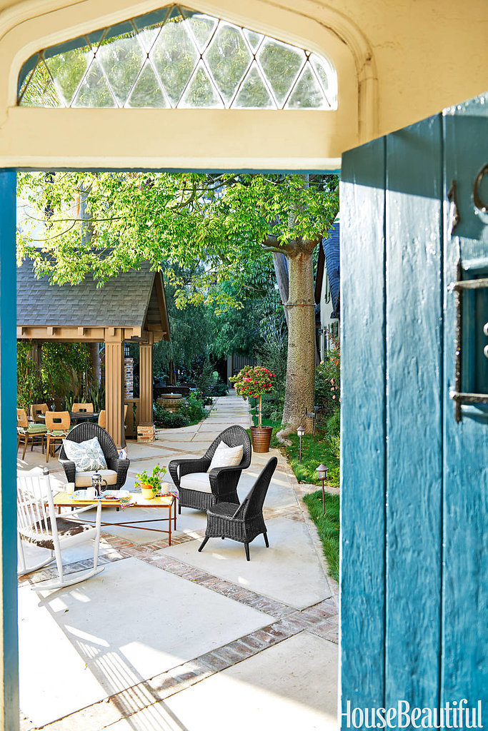 This bright blue door might just be our favorite part of the home! It sets the tone for the rest of the space and adds a playful vibe to the communal patio.  For a complete look at this Los Angeles home, head to HouseBeautiful.com. Source: Amy Neunsinger via House Beautiful
