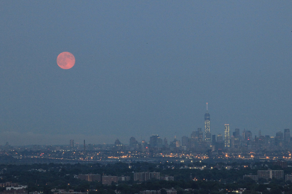 The supermoon shines over the New York City skyline.