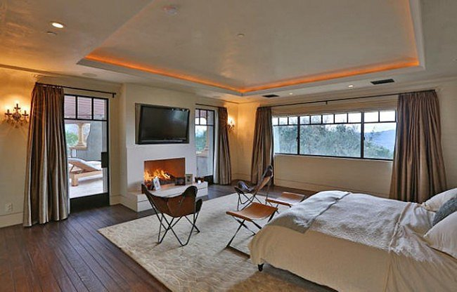 The master suite has a fireplace and stunning views of the surrounding mountains.  Source: Trulia