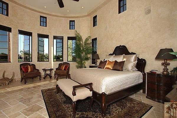 Soaring ceilings make the master bedroom feel especially grand. Source: Realtor.com