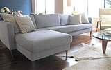 For this sofa makeover, there's no cutting, painting, or gluing involved! All you need to do is replace the original legs on an Ikea couch with new ones (found here) for a more expensive, midcentury look.  Photo: Lisette Mejia