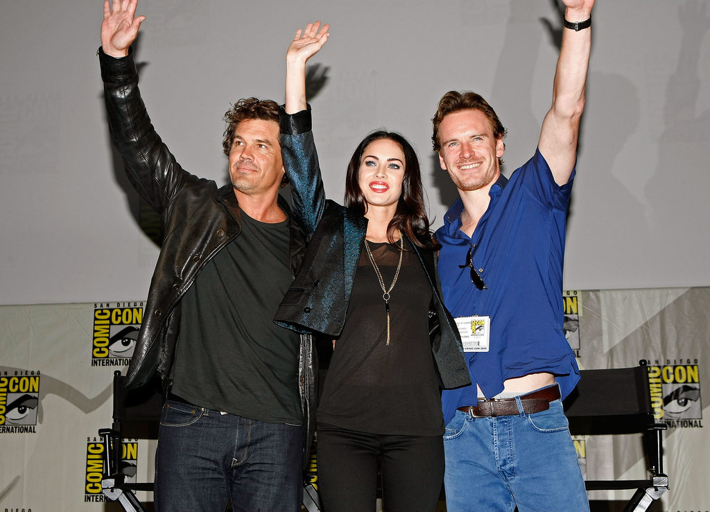 Josh Brolin, Megan Fox, and Michael Fassbender waved to fans as they took the stage at a panel for Jonah Hex in 2009.