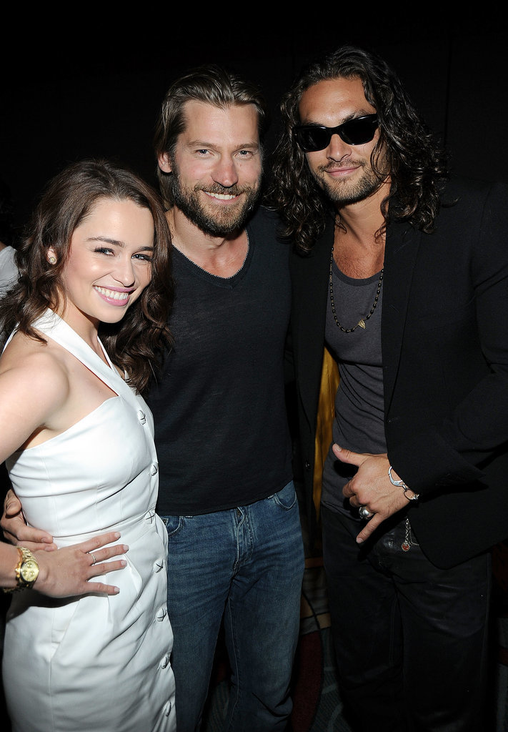 Game of Thrones stars Emilia Clarke, Nikolaj Coster-Waldau, and Jason Momoa posed together at the HBO panel in 2011.