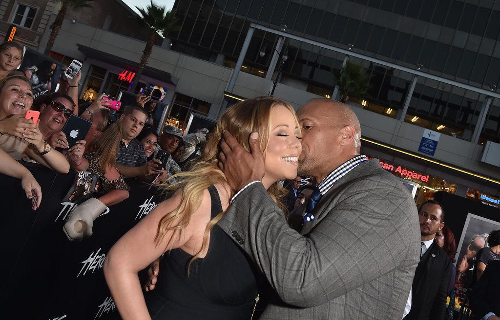 "Mariah Carey got a kiss from Dwayne ""The Rock"" Johnson at the Hercules"