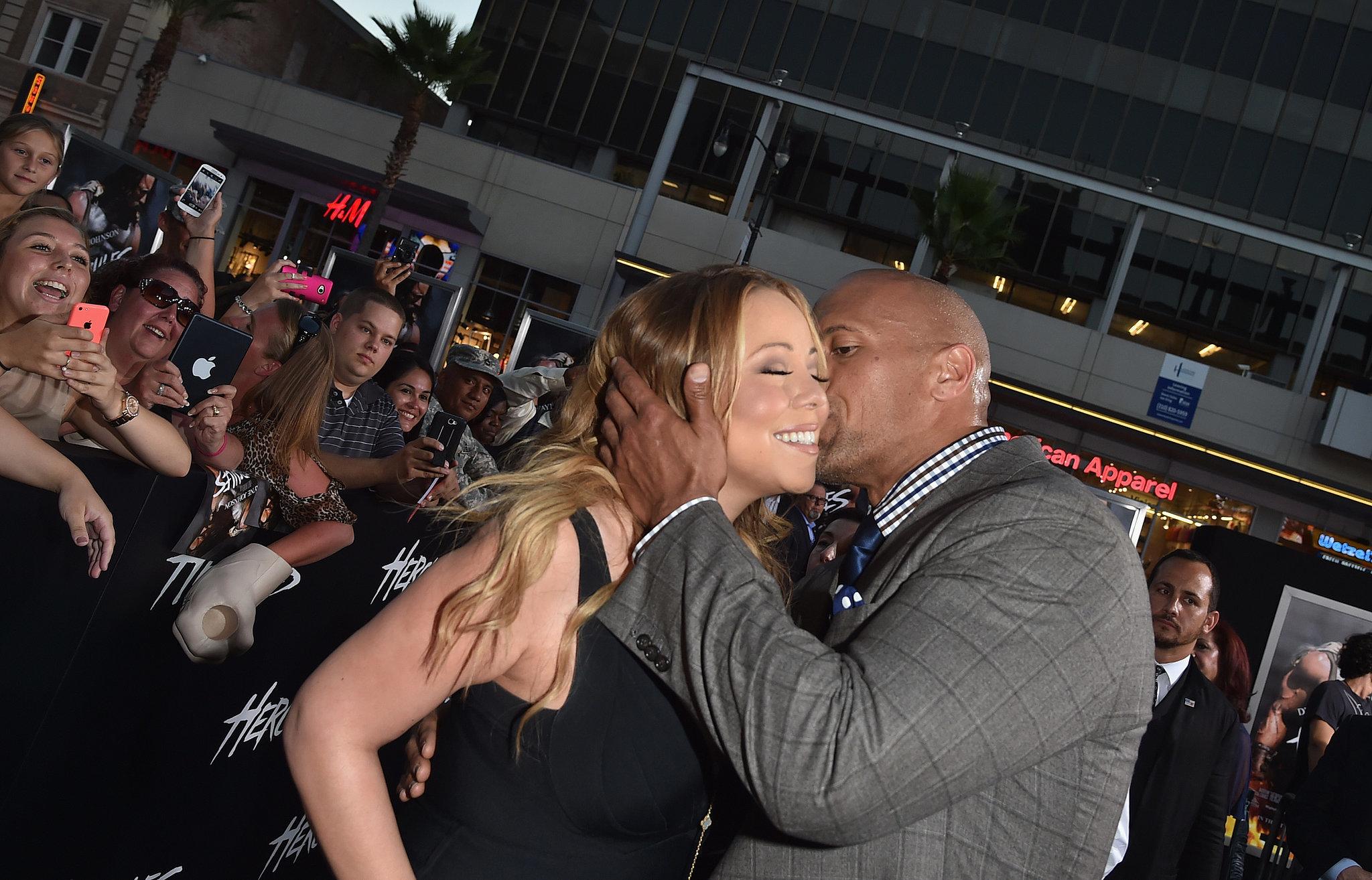 "Mariah Carey got a kiss from Dwayne ""The Rock"" Johnson at the Hercules ..."
