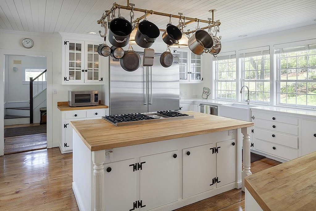 The updated country kitchen has both granite and butcher-block countertops as well as top-of-the-line appliances. Source: Landvest
