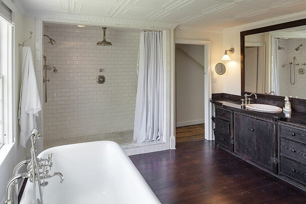 Although modern and updated, the master bath still has the traditional, antique details.   Source: Landvest