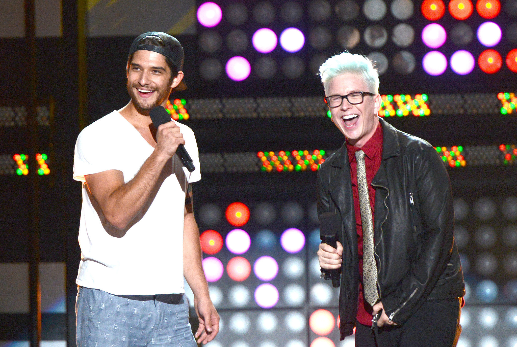 POPSUGAR's Top That! cohost Tyler Oakley laughed with Teen Wolf's Tyler Posey at the MTVu Fandom Awards on Thursday.