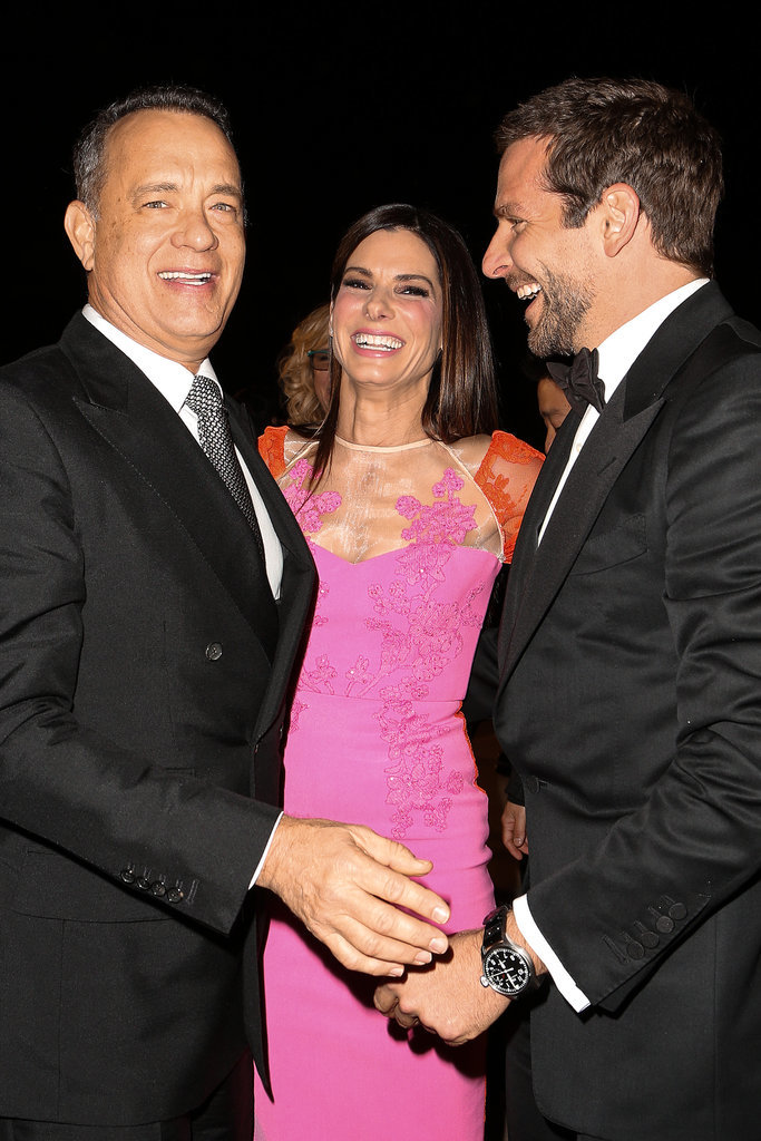 Sandra shared a laugh with Tom Hanks and Bradley Cooper at the Palm Springs Film Festival in January 2014.