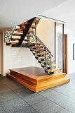 This staircase serves as functional art.  Source: Town Real Estate