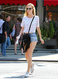 Poppy Delevingne went for a quirky crop top that's covered in pineapples and flamingos, and completed her look with classic cool-girl essentials like low-top Converse, a fringe crossbody bag, and Ray-Bans. Ultimately, she's giving off major Summer vibes, reinforcing the idea that there's still time left to have a little fun. Source: FameFlynet / Teach