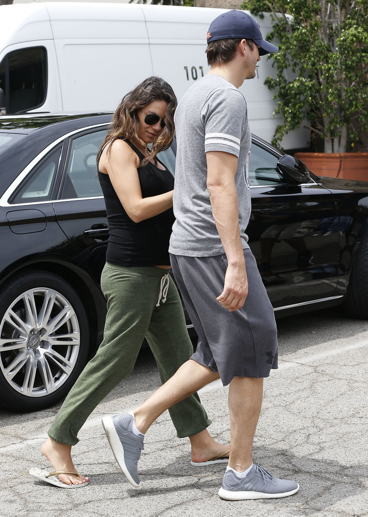On Saturday, Mila Kunis held on to Ashton Kutcher's arm while the couple ran errands in LA.