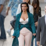 Kim Kardashian Changes Diapers in Couture